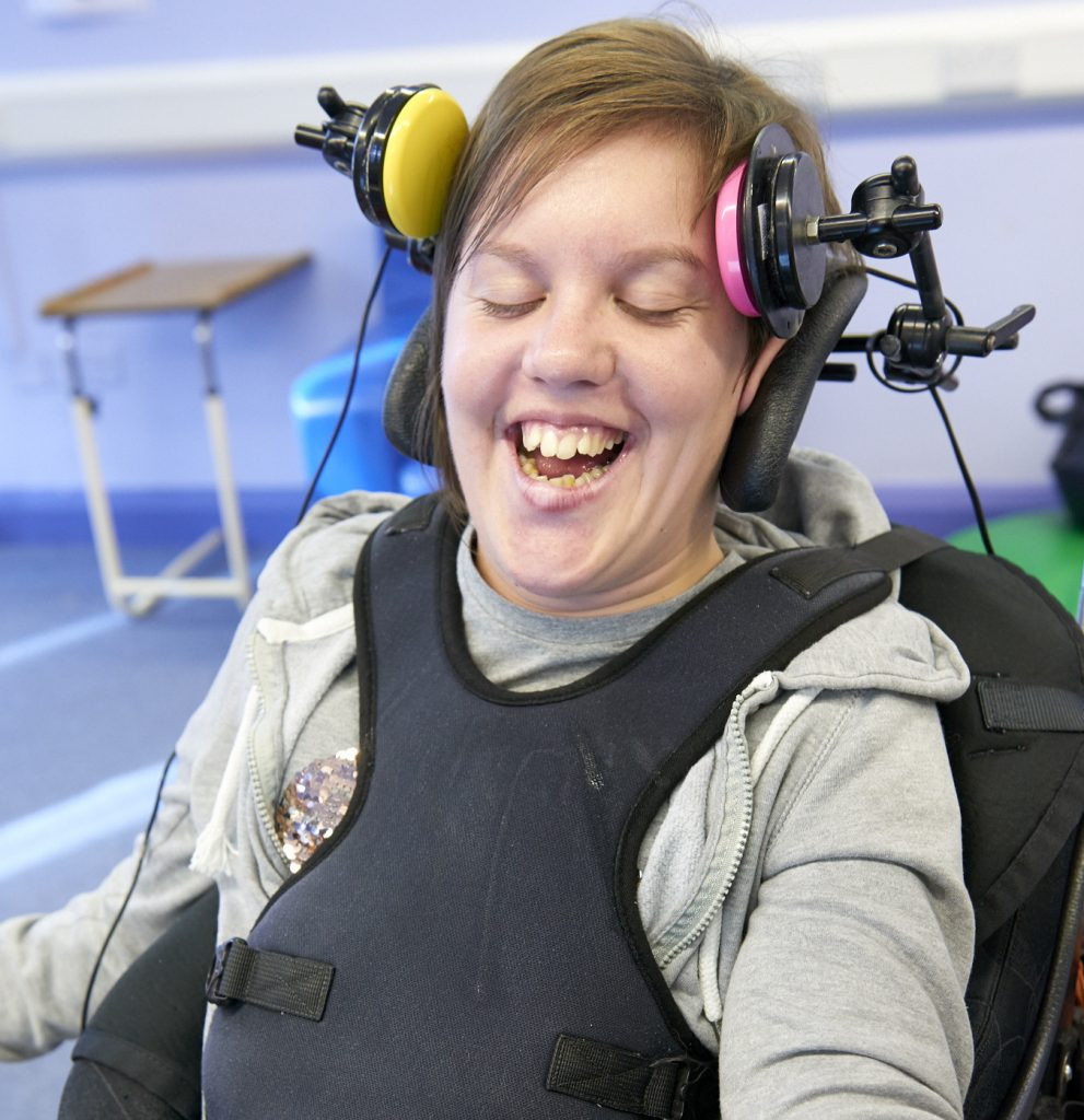 Student Mary using assistive technology in her music lesson