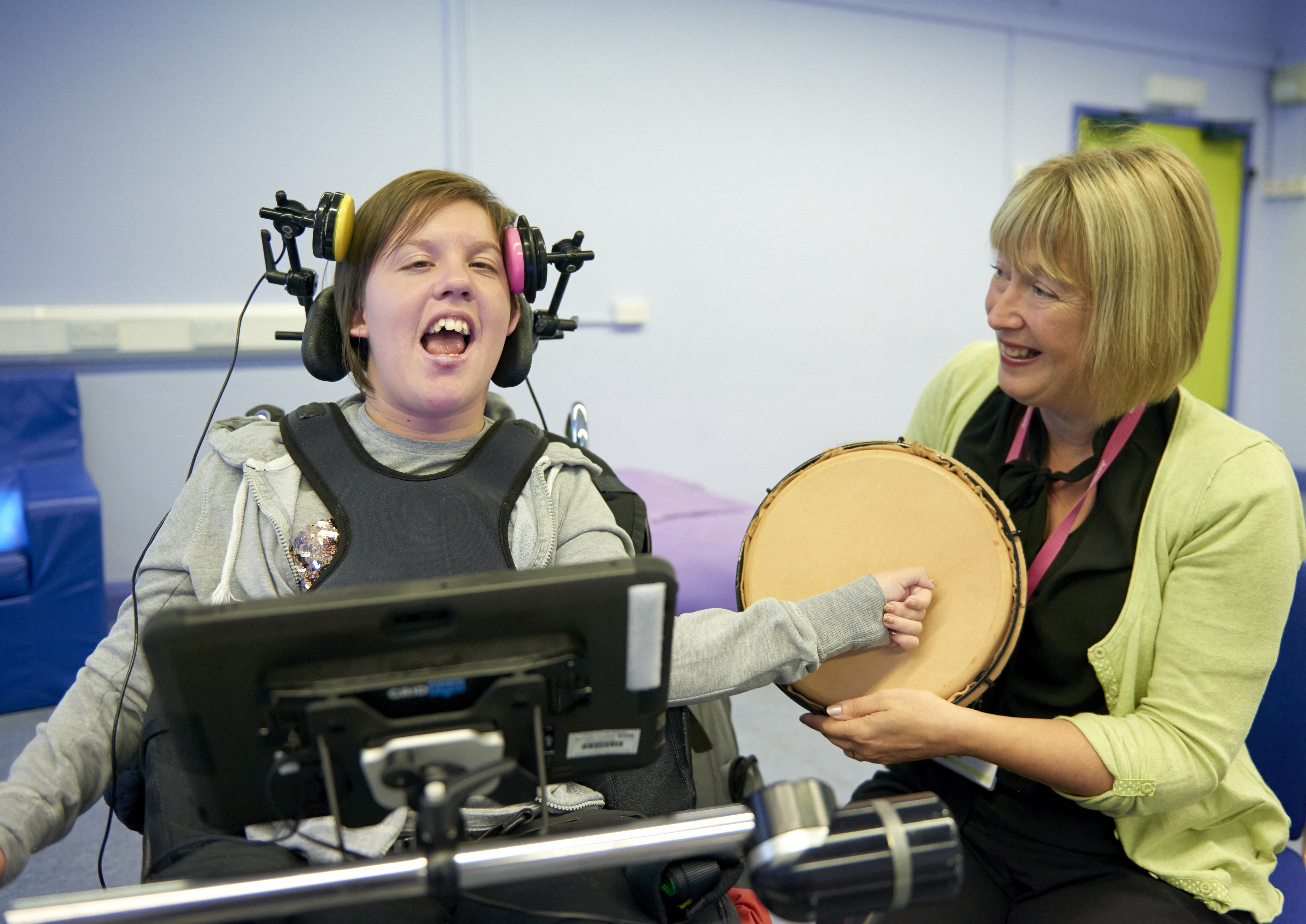 Student Mary Hinde banging on a tambourine in music class