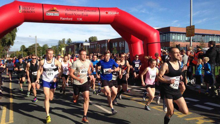 Image of runners leaving the start line at the Rainford 10k.