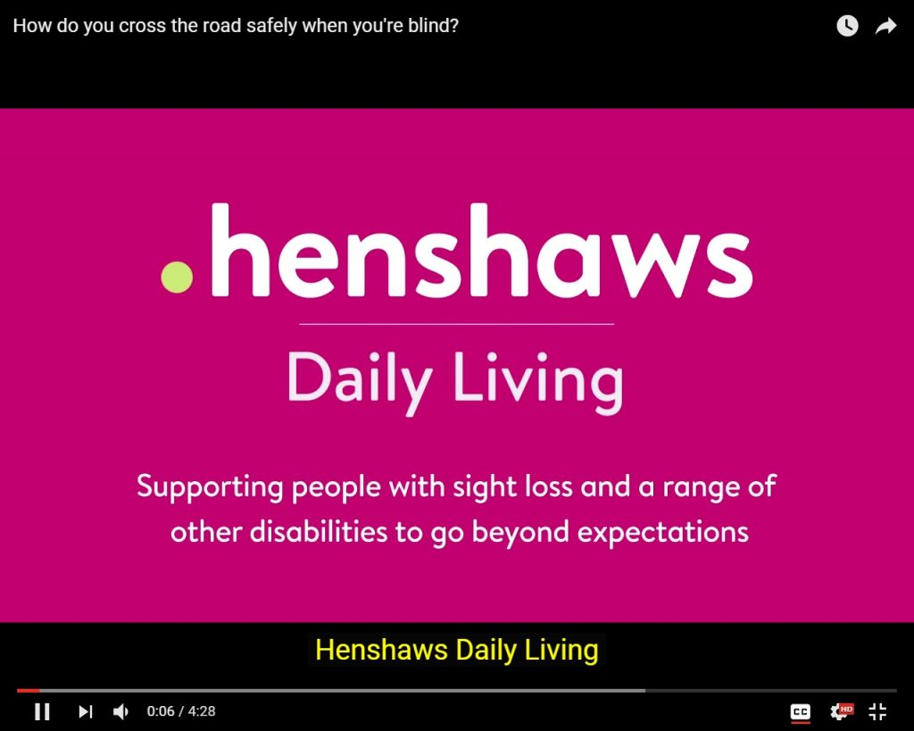 A screenshot of a Henshaws 'Daily Living' YouTube video, with closed captioning visible underneath.