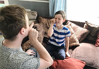 Carl using Makaton with a young boy