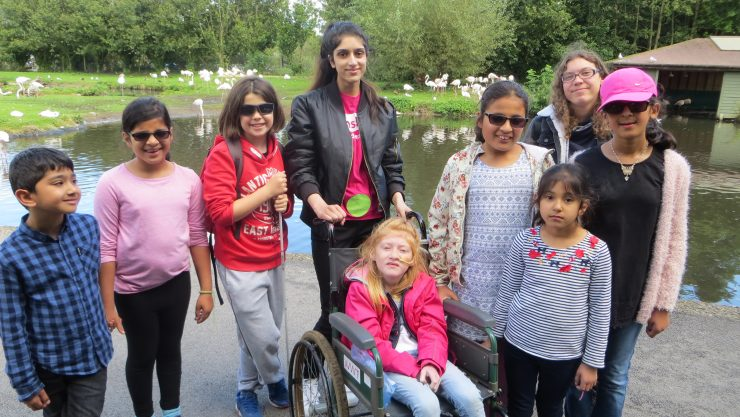 Group of children smiling at the camera in front of a river at Martin Mere.
