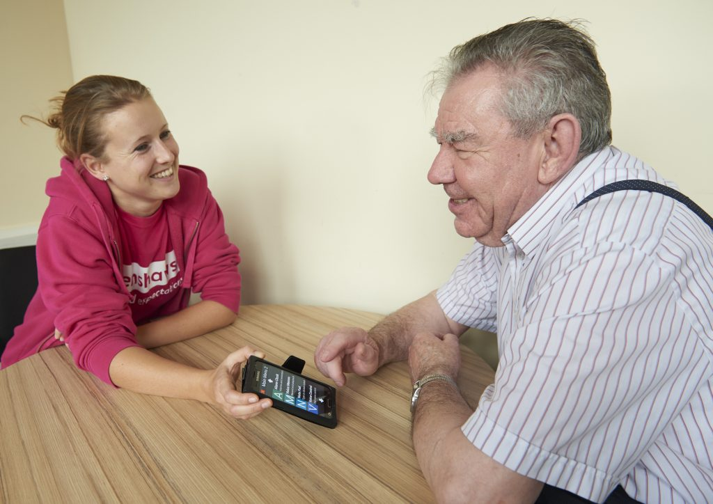 Carrie demonstrating an app to a service user