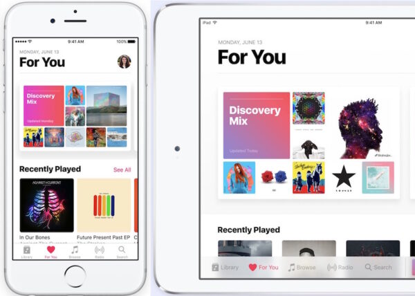 White iPhone and iPad with Apple Music on the screens.