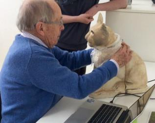 Henshaws Group Member, Peter Ball, handling the Digital Touch replica of the wooden Egyptian cat sarcophagus, with concealed touch sensors, which deliver audible information to the handler.