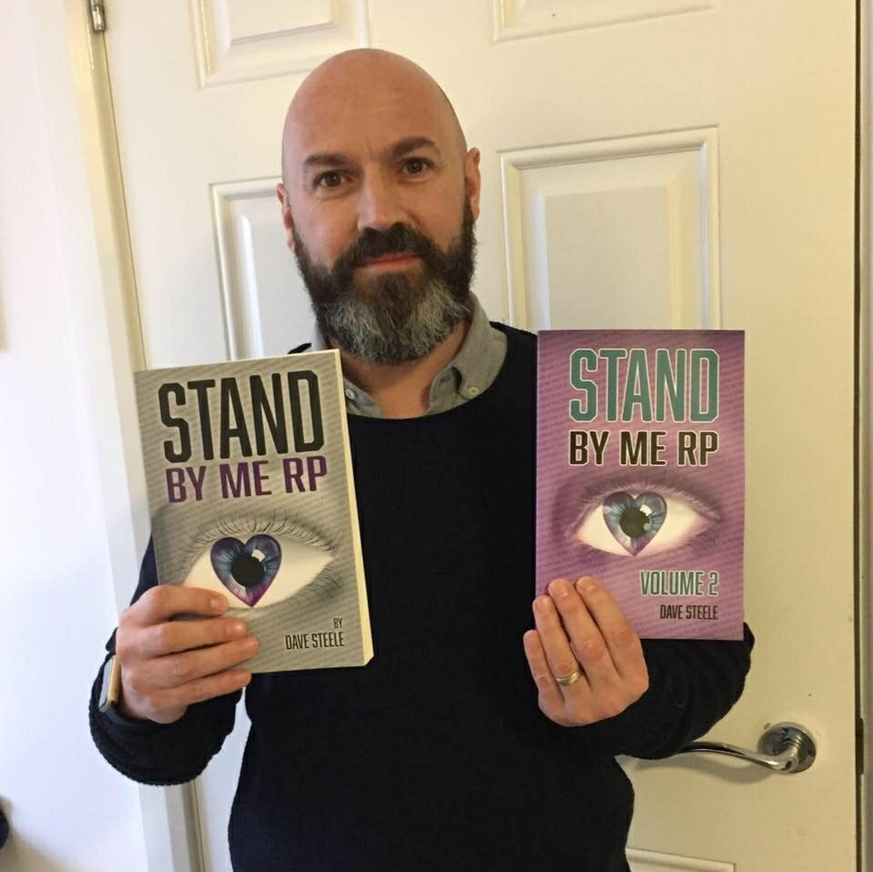 Photo of Dave Steele holding two books