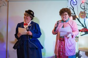 Two women dressed up as Mary Poppins and Mrs Brown
