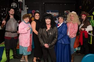 """A line up of seven men and women dressed up as """"celebrity"""" judges at Henshaws Got Talent"""