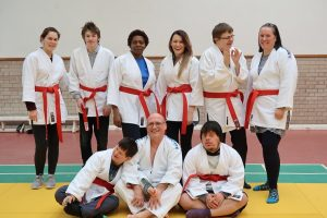 Henshaws Specialist College students and staff receive their red judo belts