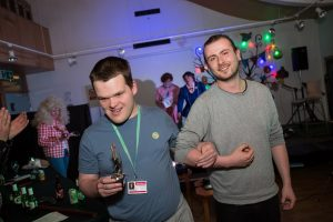 A male student and his enabler at Henshaws Got Talent