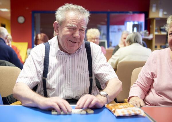 Frank-playing-domino's-at-Henshaws-Tuesday-Group