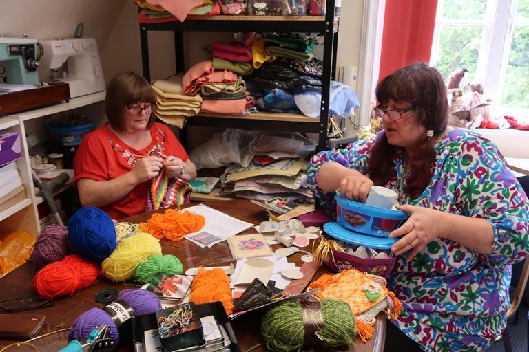 Photo showing volunteers crafting
