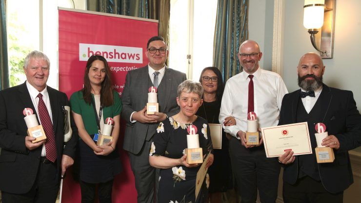 Henshaws award winners holding their awards