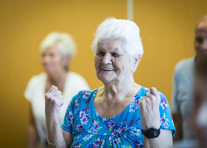 Woman pumping her arms at the Salford exercise class.