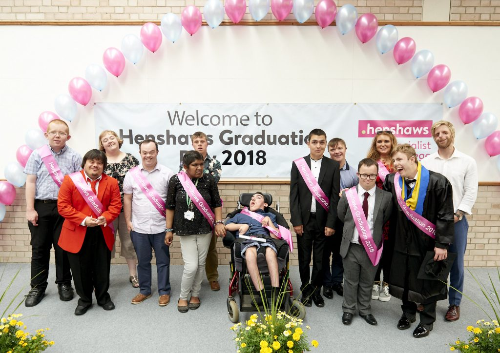 A group of disabled students graduating from Henshaws Specialist College