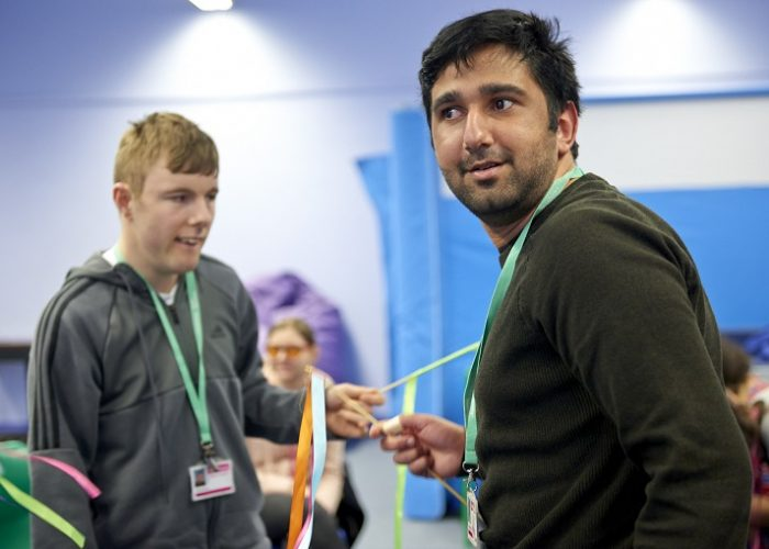 Two young men taking part in a sensory session at a specialist college