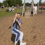 Brad laughing on a zipline