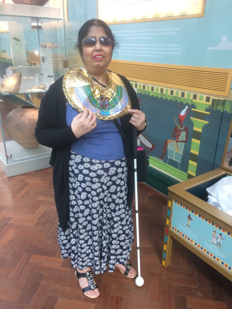 Kim in the Egyptology gallery trying on the costumes