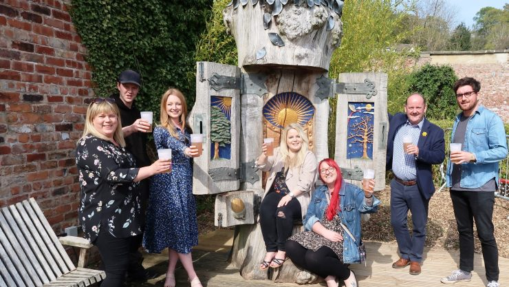 Staff from Henshaws and event sponsors Jelf and CNG taste 'Br-ale, Henshaws root and fruit beer in the Arts & Crafts Centre Courtyard.