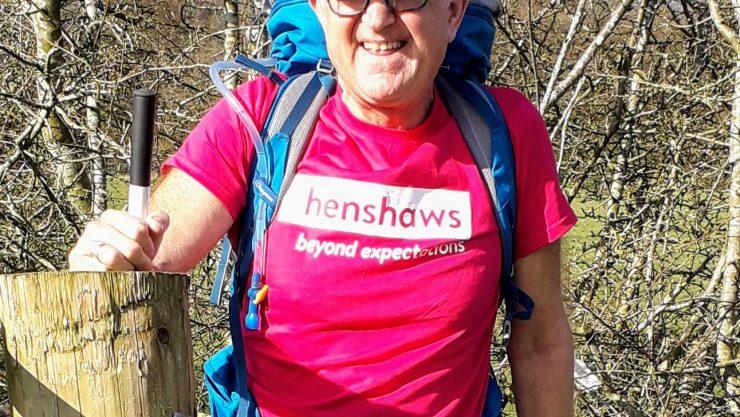 Dave wearing a pink Henshaws t-shirt