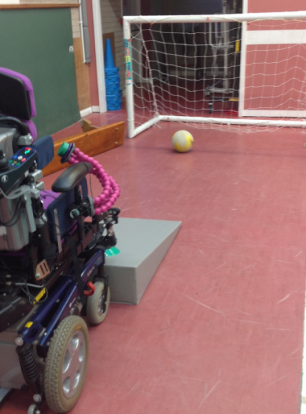 Set up for a wheelchair user to score into a football goal in a specialist physiotherapy session