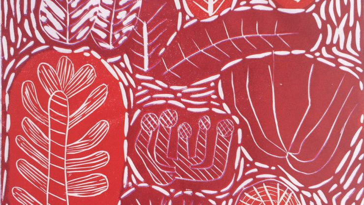 Lino print of coral reef in reds and oranges is one of the artworks on display for Henshaws 21 Exhibition