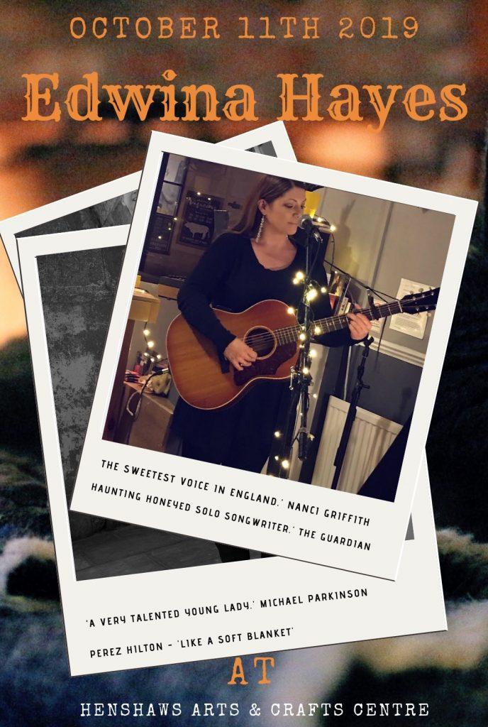 Image of Edwina Hayes singing and playing guitar