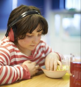 Child picking something out of a bowl