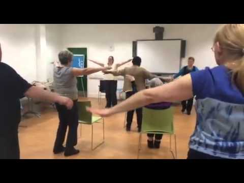Group of people doing exercises indoors