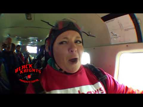 Amy and Dave in an airplane before her skydive