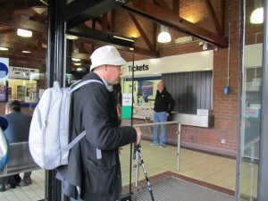 Photo of Andrew at a train station