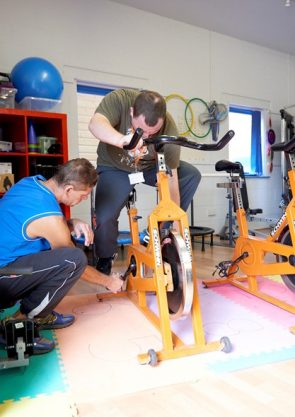 People training on an exercise bike