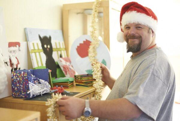 John wearing a santa hat