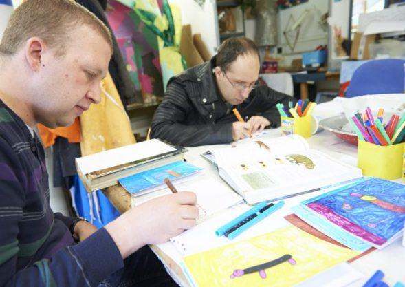 Art makers sat designing