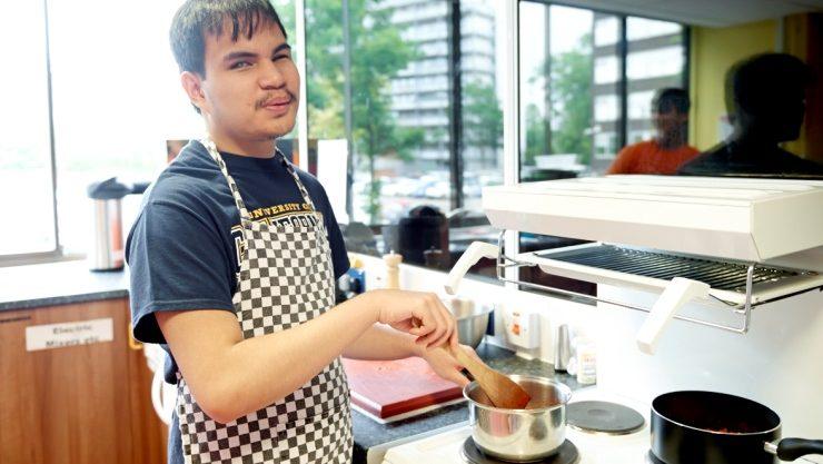 IMCYP student Robin cooking