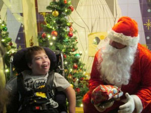 Man dressed as Santa with a wheelchair user