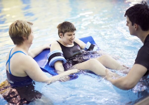 A picture of a student rehab session in Henshaws pool