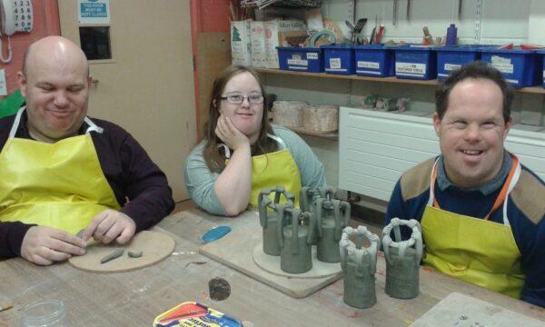 Three Henshaws art makers sat in a workshop