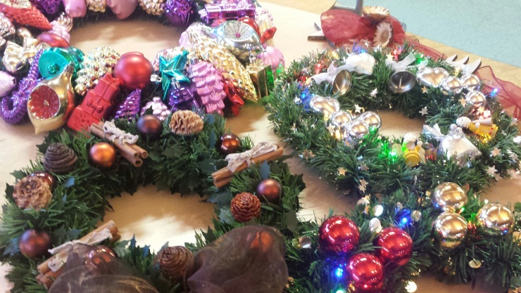 Mixture of Christmas wreathes, on table