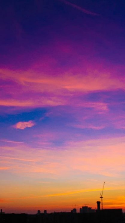 A dramatic sky at sunset, ablaze with purples, pink and orange