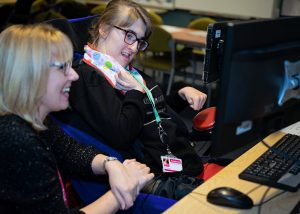 Student with PMLD being helped by SEND teacher at Specialist College Henshaws