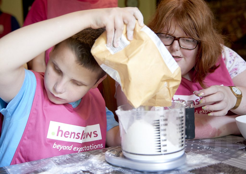 Children learning at home by cooking