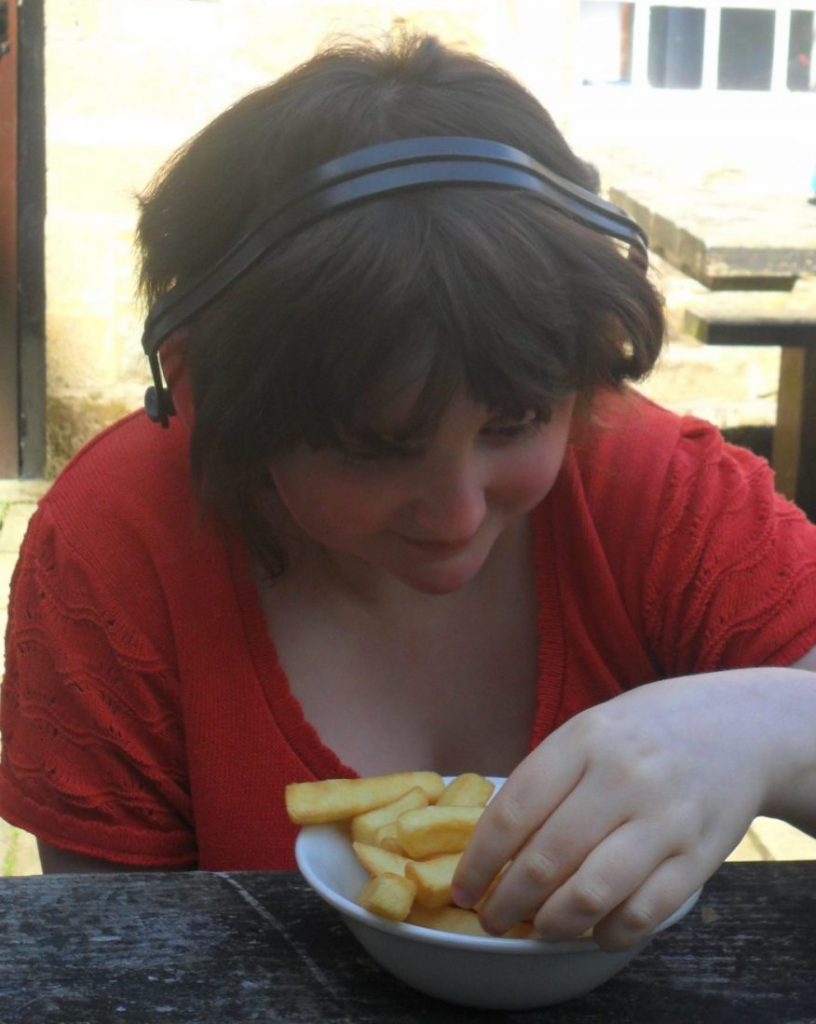Tess eating chips in the sun