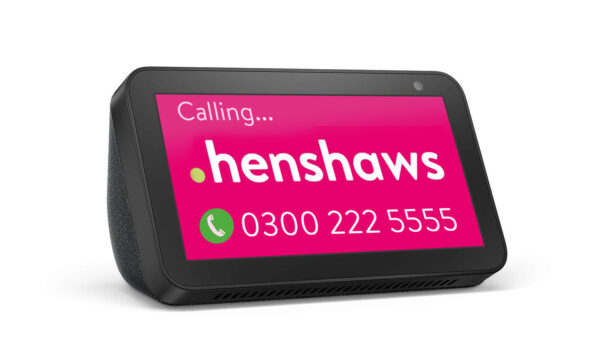 An Amazon Echo Show device with Henshaws logo on the screen