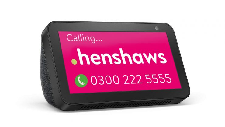 Image shows an Amazon Echo Show device with Henshaws logo on the screen