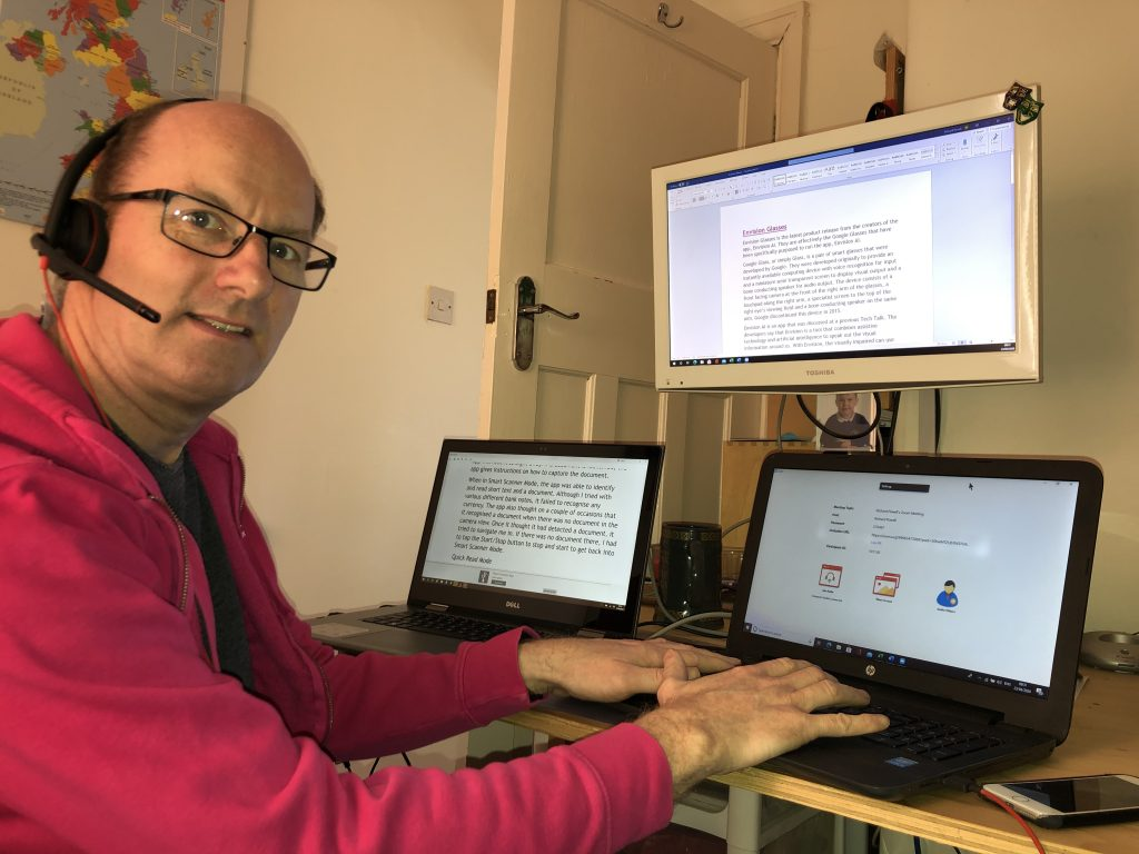 Image shows a member of the Digital Enablement Team sat at a desk with several laptops on.