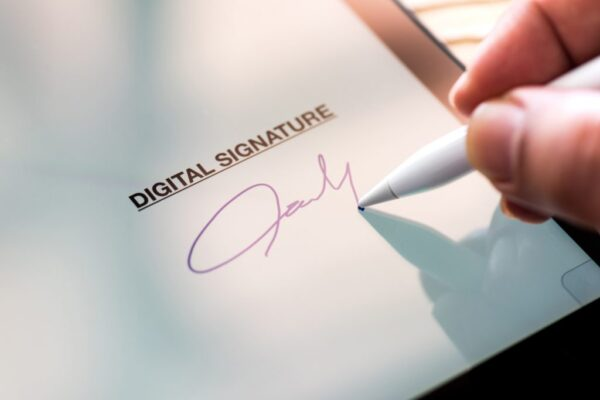 Pen signing a piece of paper
