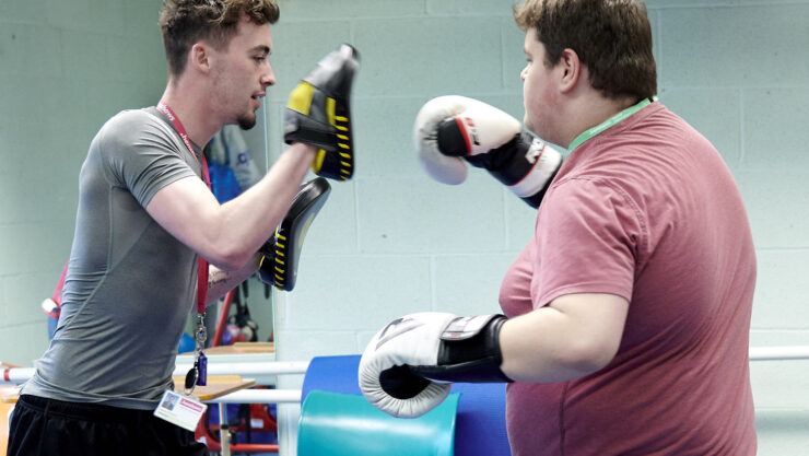 Student learning boxing in our sports centre