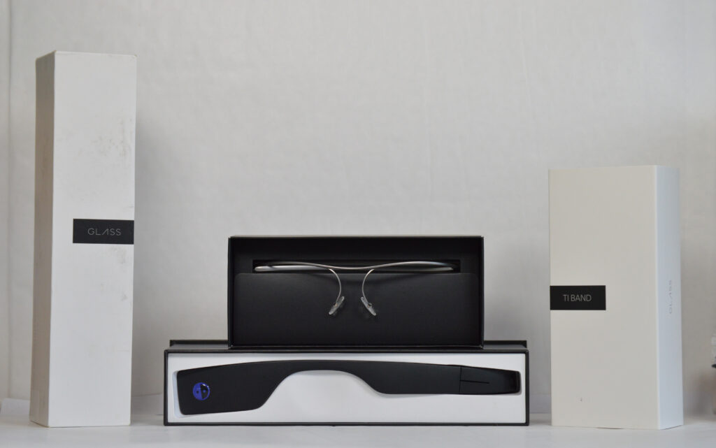 Box containing Envision glasses with the frames visible