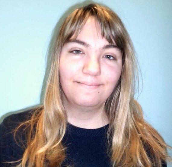Lara smiling at the camera